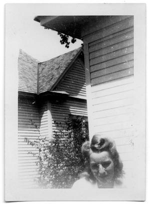 Primary view of object titled 'Woman standing outside of a house'.