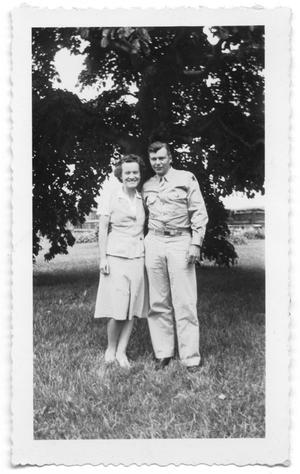 Primary view of object titled 'Couple standing together under a tree'.