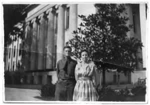 Primary view of object titled 'Unidentified couple outside a government building'.