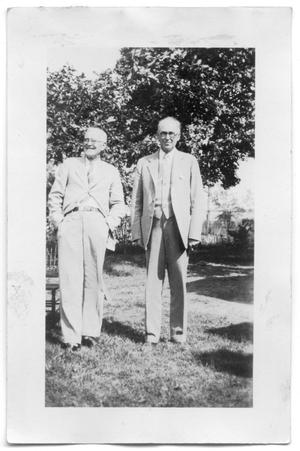 Primary view of object titled 'Henry and Robert Scrivner outside a house'.