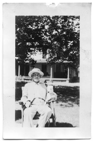 Primary view of object titled 'Henry Scrivner sitting outside the Polk St. house'.