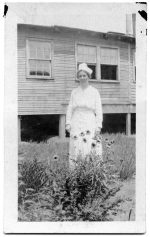 Primary view of object titled 'Nurse standing next to an elevated building'.