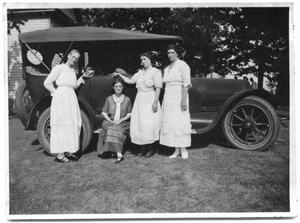 Primary view of object titled 'Dallie Scrivner, Sammie Vise, Allie Conrady and Neely Scrivner stand next to a Cadillac'.