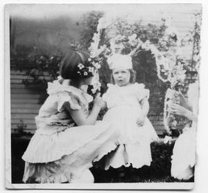 Primary view of object titled 'Unidentfied girl and a toddler in white dresses'.
