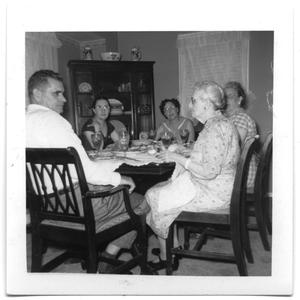 Primary view of object titled 'Members of the Lewis and Vise family reunited at a dinner table'.