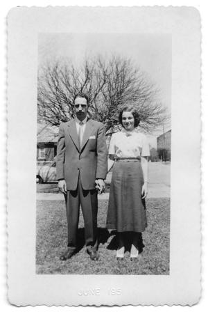 Primary view of object titled 'Gene and his daughter Anne in the front yard of a house'.