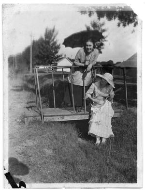 Primary view of object titled 'Elizabeth Scrivner and another woman stand on a small bridge'.