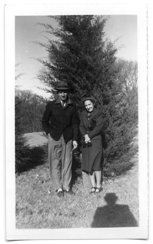 Primary view of object titled 'Gene and Rebbie Vise in front of a tree'.