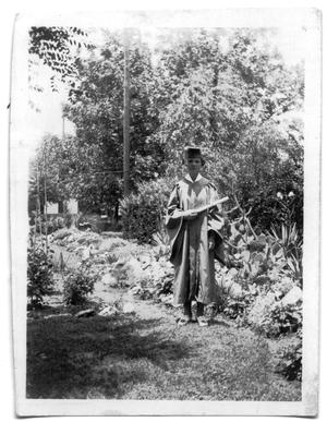 Primary view of object titled '[Photograph of Cora Lee Vise Wearing a Cap and Gown]'.