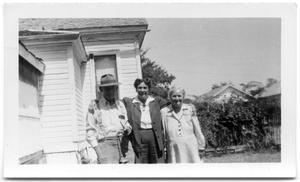 Primary view of object titled 'Relatives from the Shea family together in front of a house'.