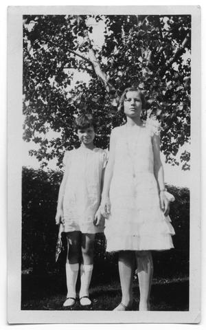 Primary view of object titled 'Cora Lee with an unidentified girl under a tree'.