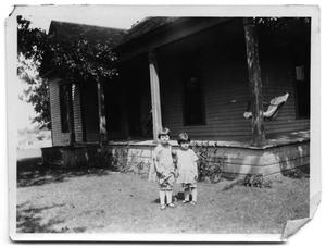 Primary view of object titled 'Two Vise toddlers standing outside the Scrivner home'.