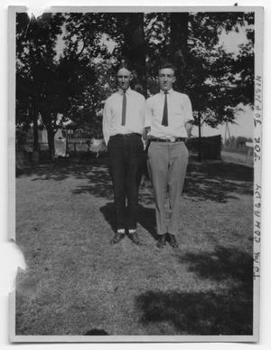Primary view of object titled 'Joe L. Johnson and Thomas Conrady in the yard of a house'.