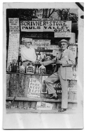 Primary view of object titled 'Poscard of two twin brothers shaking hands in Scrivner's Store'.