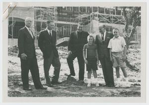 Primary view of object titled '[Group in Front of Incomplete Building]'.