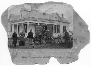 Primary view of object titled 'Theo Scrivner on a dairy wagon outside a home'.