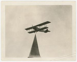Primary view of object titled '[Airplane over building]'.