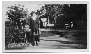 Primary view of object titled 'Neely Scrivner standing on a walkway in a park'.