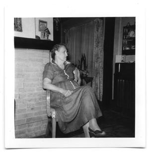 Primary view of object titled 'Allie Conrody sitting in a chair'.