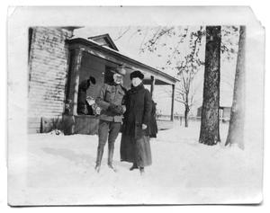 Primary view of object titled 'Sammie Vise and a park ranger outside the Scrivner home'.