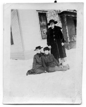 Primary view of object titled 'Portrait of three women in the snow outside a house'.