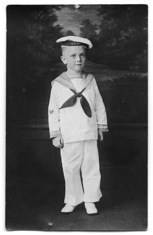 Primary view of object titled 'Postcard of a young James Edward Weber in a sailor unifiform'.
