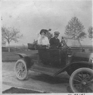 Primary view of object titled 'Lizzie Wessendorff and unidentified man in an automobile.'.