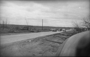Primary view of object titled 'Cars Driving After Tornado'.