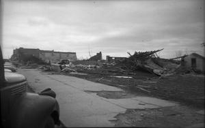 Primary view of object titled '[Photograph of Vehicles and Fallen Structure After Tornado]'.
