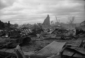 Primary view of object titled 'Group of Men and Debris After Tornado'.