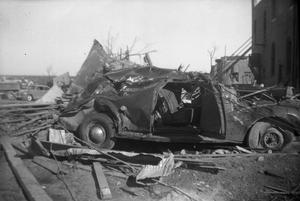 Primary view of object titled '[Destroyed Car and Collapsed Buildings After Tornado]'.