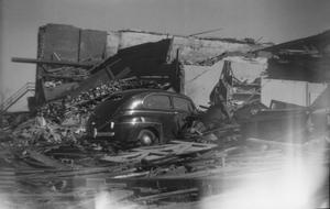 Car and Collapsed Buildings After Tornado