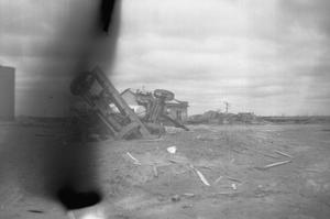 Primary view of object titled '[Photograph of an Overturned Tractor After Tornado]'.