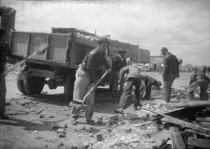 Primary view of object titled '[Photograph of Men Cleaning Tornado Debris]'.