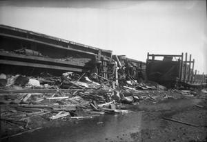 Primary view of object titled '[Photograph of Overturned Train After Tornado]'.