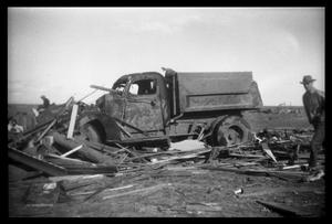 Primary view of object titled '[Photograph of Man and Damaged Truck]'.
