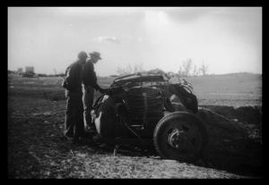 Primary view of object titled '[Photograph of Men and Tornado-Damaged Vehicle]'.