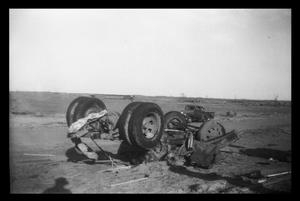 Primary view of object titled '[Photograph of an Overturned Vehicle after a Tornado]'.