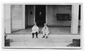 Primary view of object titled 'Two Children Sitting on a Porch'.