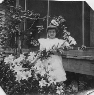 Primary view of object titled '[Katherine Elizabeth Griggs with Easter Lilies]'.