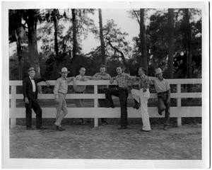 Primary view of object titled '[Seven Men by a Fence]'.