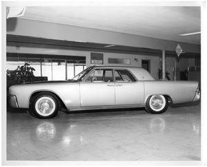 Primary view of object titled '[1961 Lincoln Continental in Showroom]'.