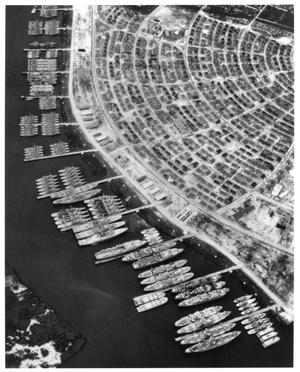 Primary view of object titled '[Aerial View of the Mothball Fleet in Orange, Texas]'.