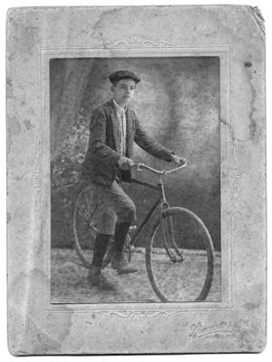 Primary view of object titled '[Boy with Bicycle]'.