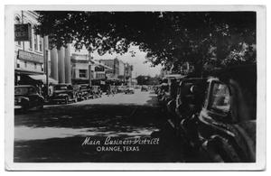 Primary view of object titled '[Main Business District in Orange, Texas]'.
