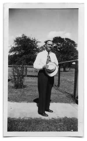 Primary view of object titled '[Dr. Wynn Pearce at the Farm]'.