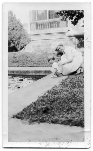 Primary view of object titled 'Carrie Brown with E.W Brown III and John S. Brown next to a pool'.