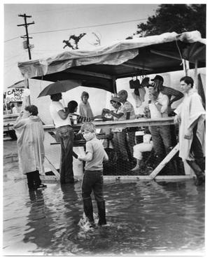 Primary view of object titled '[Photograph of Gumbo Booth in Flooded Street]'.