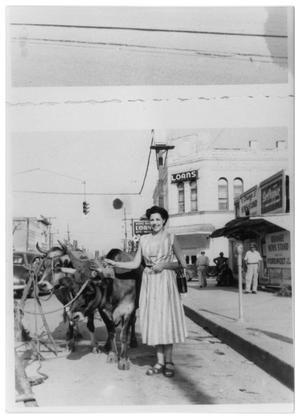 Primary view of object titled '[Woman with Oxen on Front and Fifth Street]'.