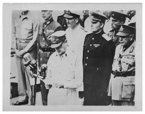 Primary view of object titled '[General Douglas MacArthur addresses dignitaries at the signing of the Japanese Surrender]'.